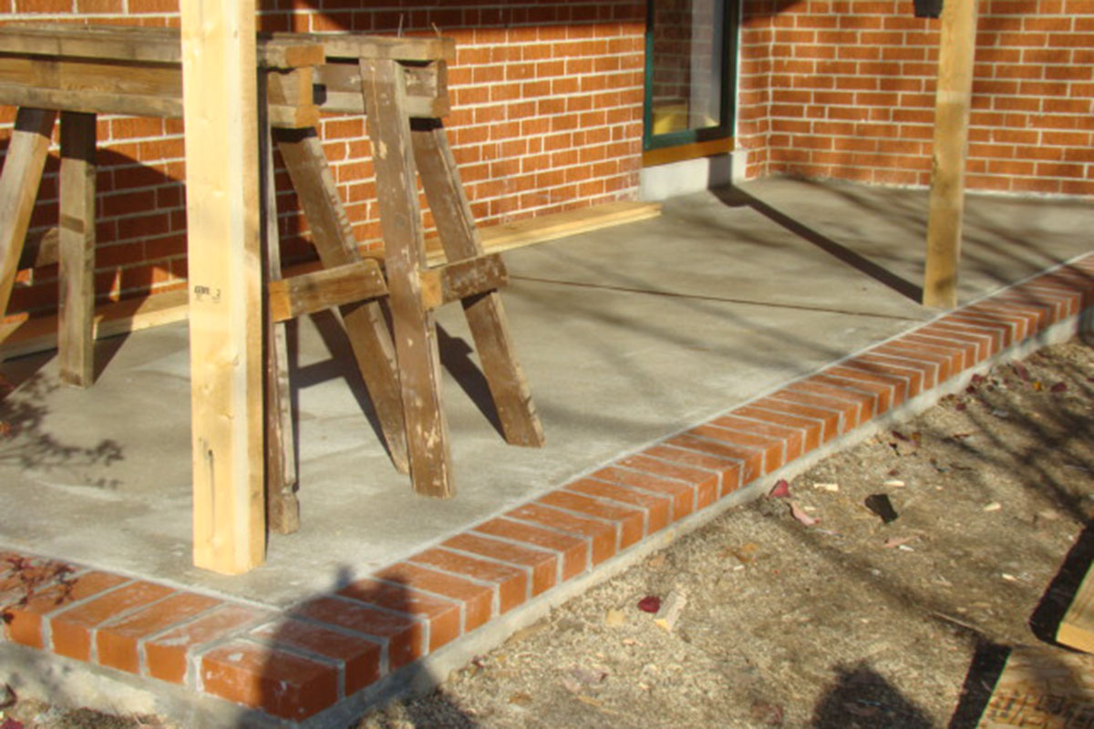 Concrete Porch with Brick Trim