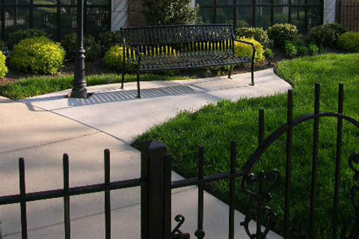 Concrete sidewalk w bench